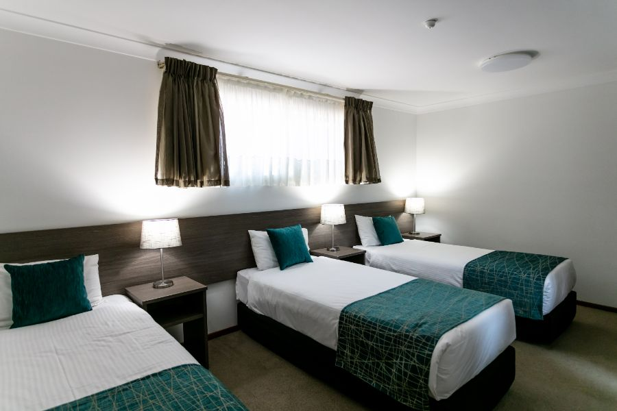 Family Suite with 3 Single Beds & 1 Queen Bed